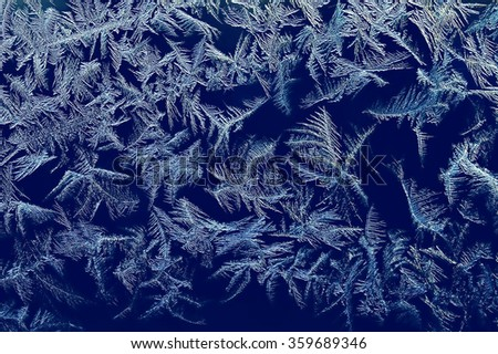 icy pattern on dark winter frosted window/icy pattern on dark winter frosted window / winter background - stock photo