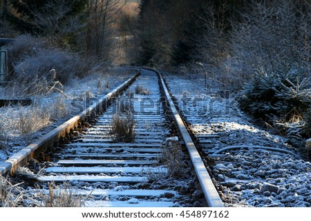 icy railroad tracks in winter - stock photo