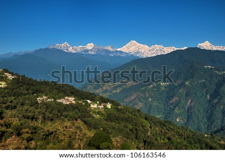 Icy range of Mount Kanchenjunga in the Himalayas as viewed from Tashi viewpoint in Gangtok, Sikkim. - stock photo