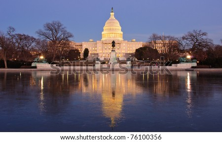 Icy reflection and the U.S. Capitol at sunset. Washington, DC - stock photo