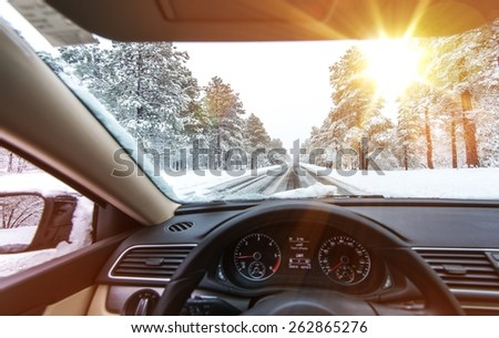 Icy Road Winter Drive. Winter Conditions on the Road with Sunny Sky. Driver View. - stock photo