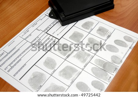 ID card with fingerprints on table - stock photo