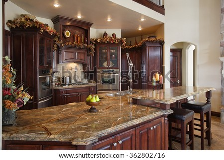 Idaho Falls, Idaho, USA, Feb. 28, 2008 The kitchen in a custom built upscale home, with professional appliances, and granite counter tops. - stock photo