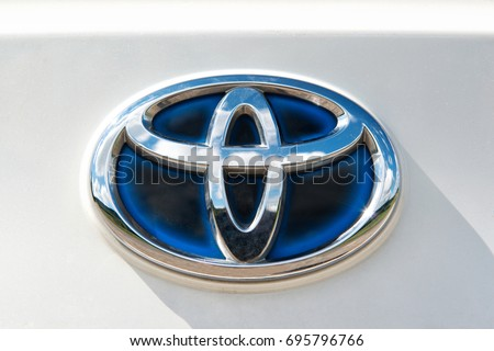 IDAR-OBERSTEIN, GERMANY - AUGUST 13, 2017: Toyota Hybrid logo on a white Toyota Auris car outdoors