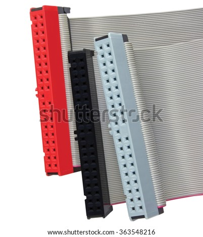 IDE connectors and ribbon cables for hard drive on PC computer, isolated, red, grey, black, large detailed macro closeup - stock photo