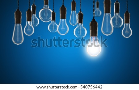 Idea and leadership concept - Vintage bulbs on the color background
