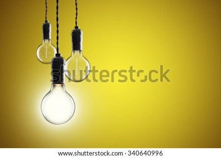 Idea and leadership concept Vintage incandescent light bulbs on color wall
