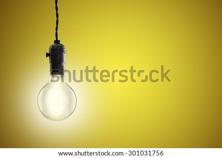 Idea concept -  incandescent bulb on red background