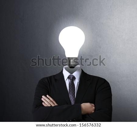 idea concept, lamp head businessman  - stock photo