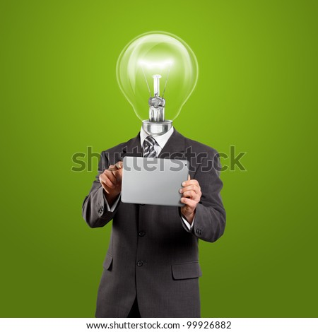 Idea concept, lamp head businessman in suit with touch pad in his hands - stock photo