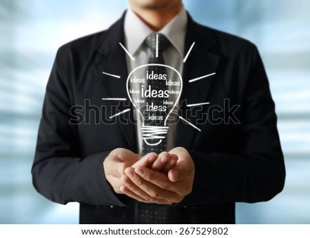 idea concept, man holding light bulb - stock photo