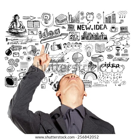Idea concept with businessman looking upwards and showing something with finger on sketch background - stock photo