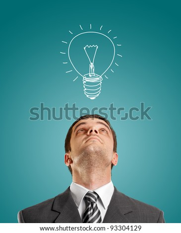 idea concept with businessman looking upwards, with suit and necktie - stock photo