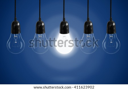 Idea concept with light bulb on the background color.