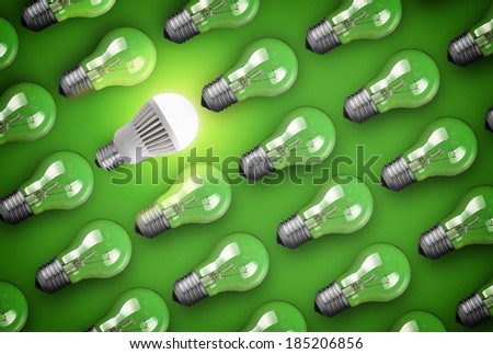 Idea concept with light bulbs on green background - stock photo