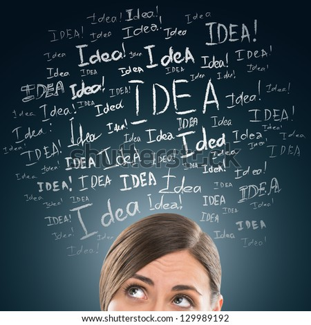 Idea concept. Young business woman with idea signs in front - stock photo