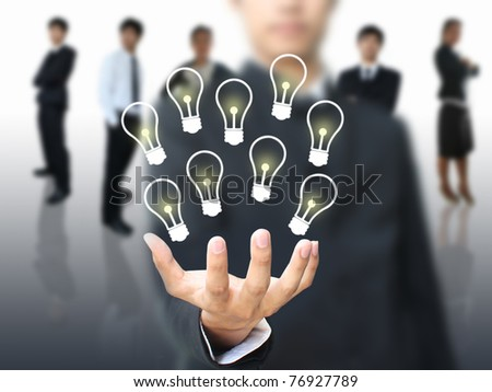 Idea in business hand - stock photo
