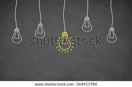 Idea Light Bulb on Blackboard. Business concept.