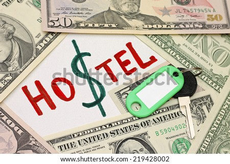 Idea of saving - hostel cheaper than hotel - stock photo