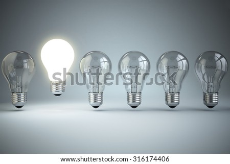 Idea or uniqueness, originality concept. Row of light bulbs with glowing one. 3d
