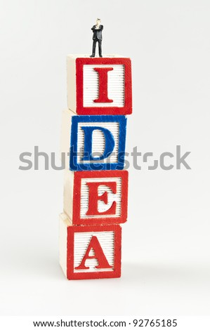 Idea word and toy business man - stock photo