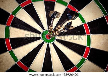 Ideal hit on bulls eye on same center - stock photo