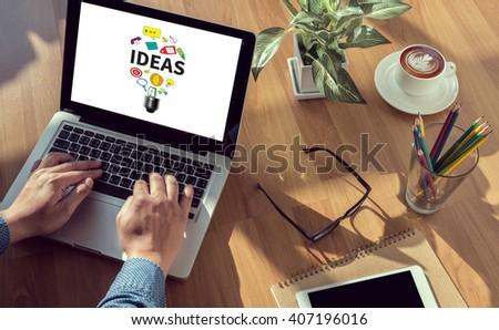 IDEAS man hand on table Business, coffee, Split tone - stock photo
