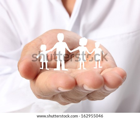 ideas,paper family in the hand  - stock photo