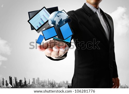Ideas, Technology in the hands with businessman - stock photo