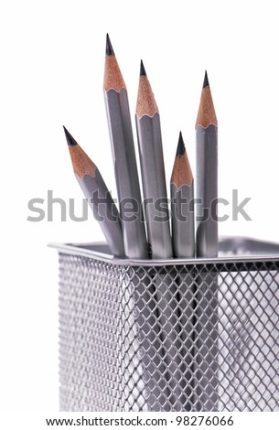 Identical sharp pencils of gray color in office support - stock photo