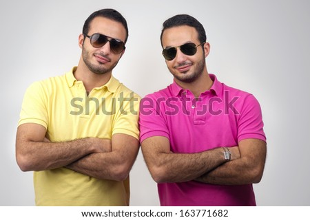Identical twins portraits shot against white background
