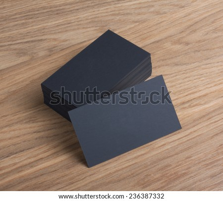 identity design, corporate templates, company style, blank business cards on a wooden background - stock photo