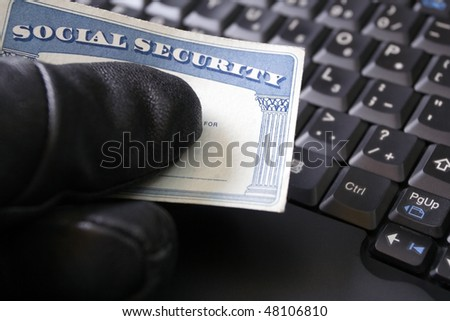 Identity theft and Social Security card, internet crime online - stock photo