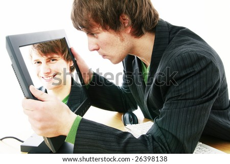 identity theft, businessman or student with image stolen from screen - stock photo