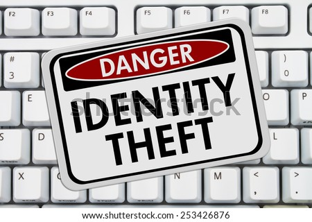 Identity Theft Danger Sign,  A red and white sign with the words Identity Theft on a keyboard - stock photo