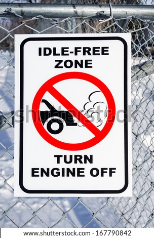 Idle-Free Zone, Turn Engine Off Sign on a Fence - stock photo