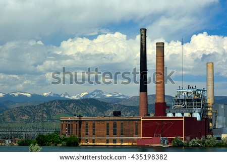 Idle Not Running Coal Fired Power Plant by a Lake - stock photo