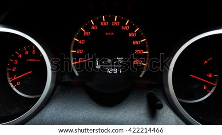 Idle Speedometer. Car Instruments Dash/Panel Closeup. RPM and Speed Metering. Transportation Photo Collection.dark tone