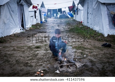 Idomeni, Greece. 26 April 2016. 14.000 refugees stuck in Greek borders as FYROM has closed the borders.The weather is bad with cold and rain. People are sick 7000 children and there is not enough food