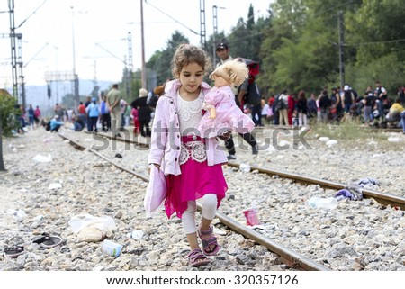 Idomeni, Greece - September 24 , 2015: Hundreds of immigrants are in a wait at the border between Greece and FYROM waiting for the right time to continue their journey from unguarded passages - stock photo