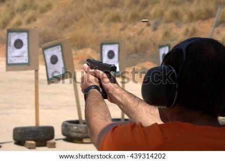 IDPA shooting training - stock photo