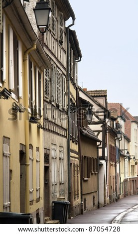 idyllic alley with house facades in Colmar (Alsace/France) - stock photo
