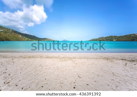 Idyllic beach at Magens Bay, Saint Thomas, US Virgin Islands. This beach is considered one of the best top ten beaches in the world. Paradise and clear water for relaxation. - stock photo