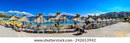 Idyllic beach in Baska panorama, Island of Krk, Croatia. Baska is famous tourist destination in Croatia. - stock photo