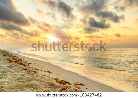Idyllic beach of Caribbean Sea at sunrise - stock photo
