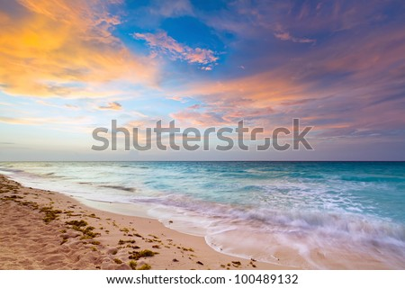 Idyllic beach of Caribbean Sea at sunrise - stock photo