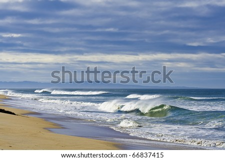 Idyllic beach under a painterly sky. - stock photo