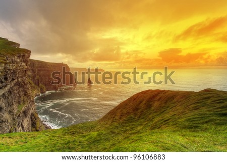 Idyllic Cliffs of Moher at sunset, Co. Clare, Ireland - stock photo