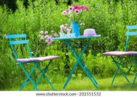 Idyllic garden with table and chair