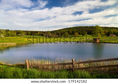 idyllic landscape in springtime with fish farming lake